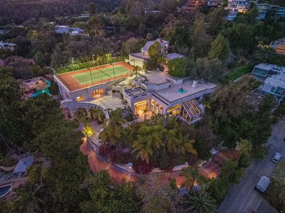 The beautiful architectural design and landscaping of the property is being showcased in this aerial view. Images courtesy of Toptenrealestatedeals.com.