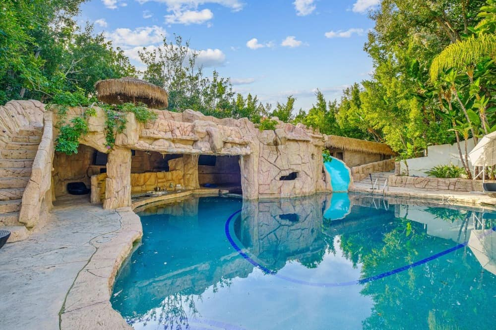 Here's the home's custom swimming pool that looks absolutely stunning. It is situated at the side of the property. Images courtesy of Toptenrealestatedeals.com.