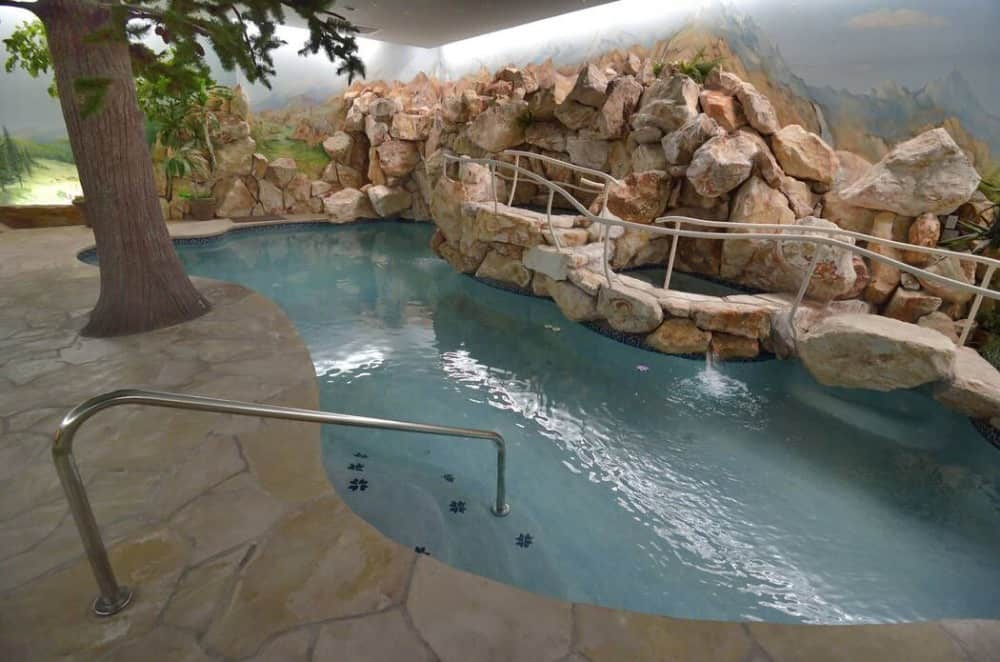 Another look at the home's custom swimming pool showcasing its beautiful design. Images courtesy of Toptenrealestatedeals.com.
