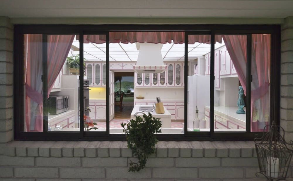 A view of the kitchen from outside, through its sliding glass windows. Images courtesy of Toptenrealestatedeals.com.
