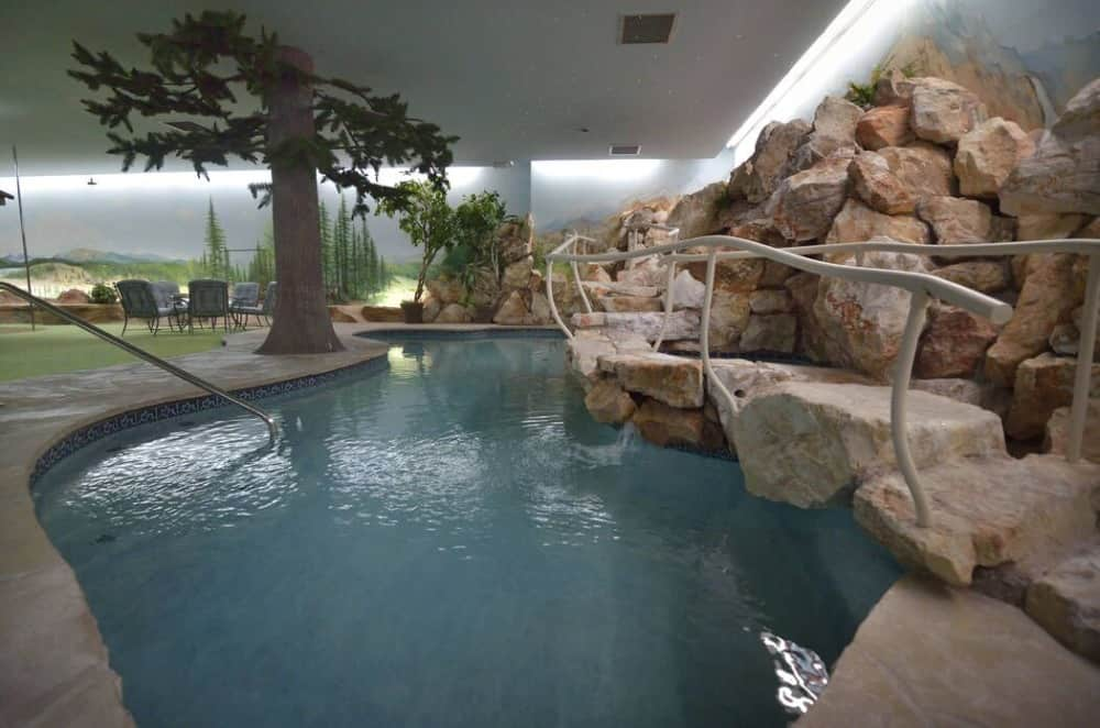 The home also boasts a custom swimming pool with a stunning stone bridge. Images courtesy of Toptenrealestatedeals.com.