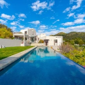 This beautiful cubist home has a large swimming pool at the back with a wonderful view of the surrounding green landscape that gives a lovely background contrast for the straight lines and cube structures of the beige house. Images courtesy of Toptenrealestatedeals.com.