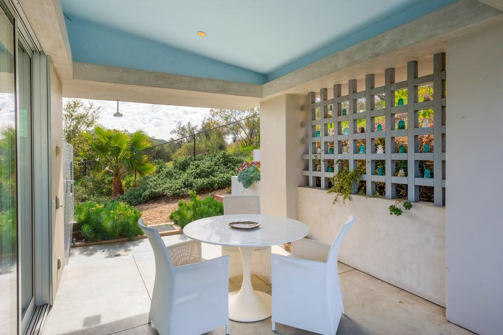 This is a covered patio on one corner of the house just outside a set of sliding glass doors. This area is fitted with a small and intimate outdoor dining area. Images courtesy of Toptenrealestatedeals.com.