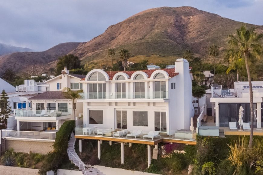 Aerial view of the house showcasing its magnificent white exterior. Images courtesy of Toptenrealestatedeals.com.