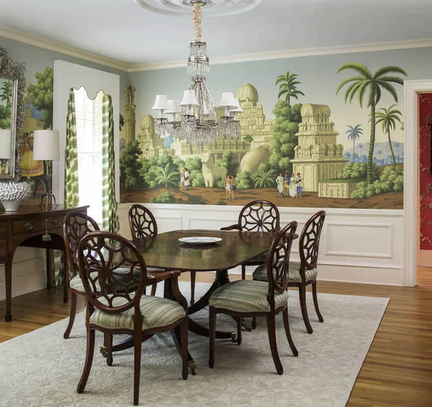 The home features a massive formal dining room, fitting for its Southern heritage. The walls in this space are uniquely wrapped in large scale mural style painting, rather than single color paint or wallpaper, which adds a hearty dose of personality and style.