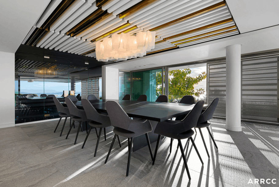 This dining room features a long contemporary dining table for 10 people in the renovated dining room.