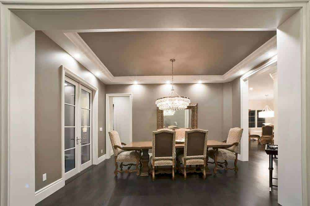 This dining area features wooden table elegant upholstered chairs that has wooden legs to match the flooring.