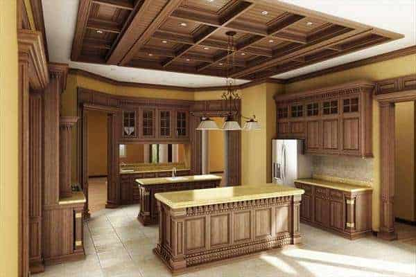 This kitchen area features a kitchen island that matches the wooden cabinetry and a gorgeous wooden ceiling.