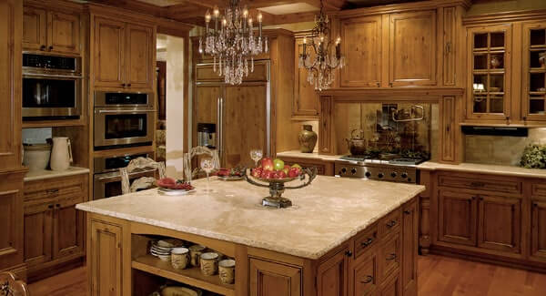 This gorgeous kitchen offers a central island and wooden cabinetry that matches the hardwood flooring.
