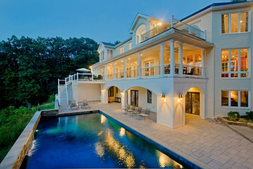 Here is an image of the back of the house with the huge back balcony that takes advantage of the view offered in the backyard.