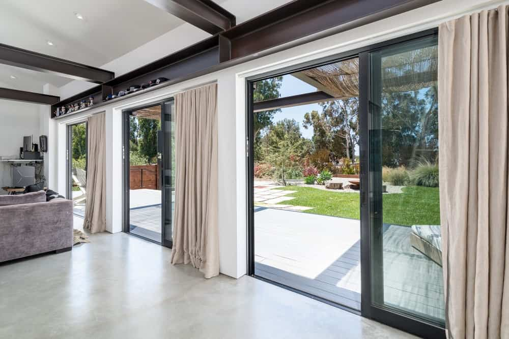 These large sliding glass doors let in an abundance of natural lighting.