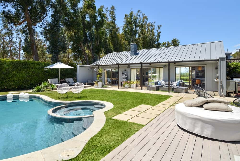 This vantage point shows the proximity of the pool from the covered patio on the side of the house.