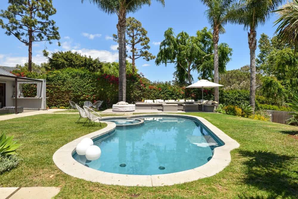 On the other end of the swimming pool is a comfortable sitting area that could fit a large group of people.