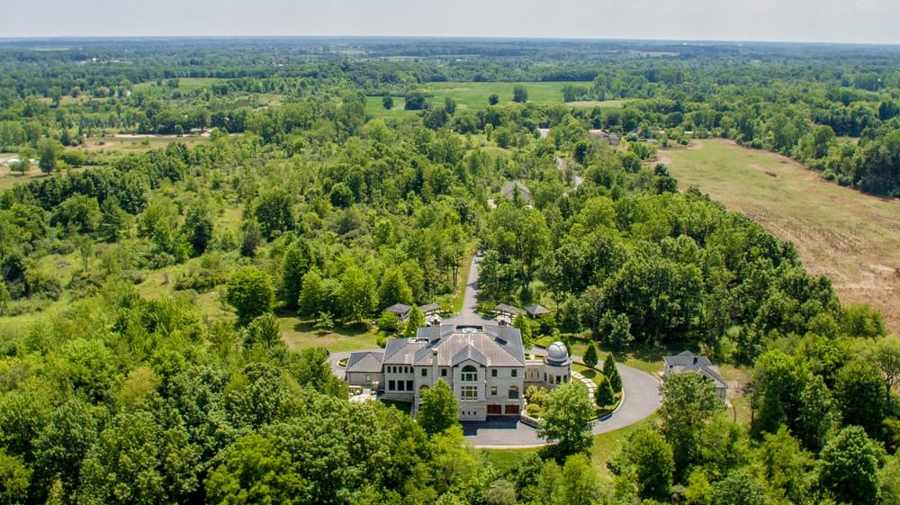This view of the house boasts of the lush landscaping surrounding the home that is traversed by wide driveways. Images courtesy of Toptenrealestatedeals.com.