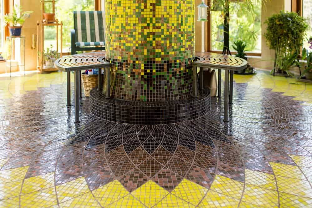 A part of the house is adorned with this gorgeous and colorful tile arrangement that depicts a sunflower centering on a pillar with built in bench. Images courtesy of Toptenrealestatedeals.com.