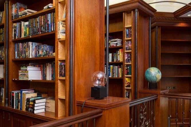 This is a closer look at the library of the house with large wooden bookshelves enough to store thousands of books. Images courtesy of Toptenrealestatedeals.com.