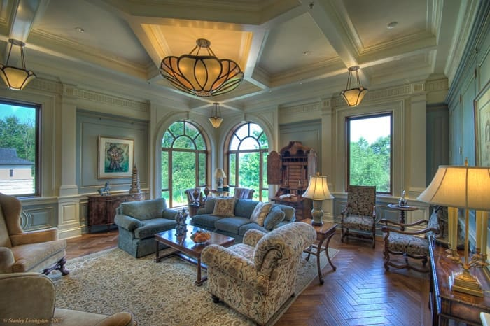 This is the charming living room with a comfortable sofa set topped with a coffered ceiling that hangs a large semi-flush mount lighting over the coffee table. Images courtesy of Toptenrealestatedeals.com.