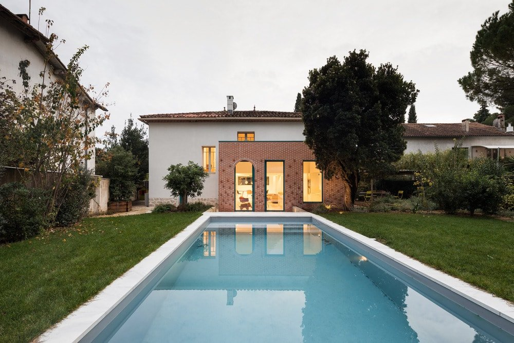 Outdoor view of the house featuring its backyard and outdoor swimming pool.