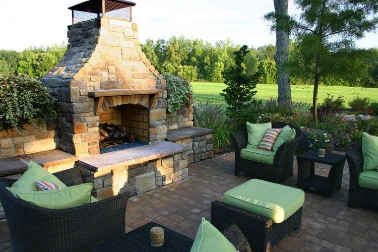 An outdoor living set with a stone fireplace. Images courtesy of Toptenrealestatedeals.com.