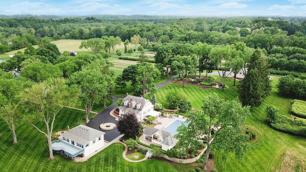 A bird's eye view of the property showcasing the lush greenery surrounding the house. Images courtesy of Toptenrealestatedeals.com.