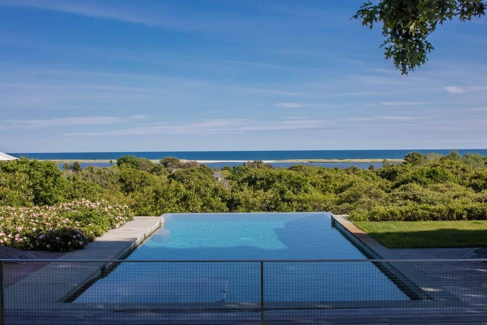 A look at the home's infinity swimming pool offering a stunning view of the surroundings. Images courtesy of Toptenrealestatedeals.com.