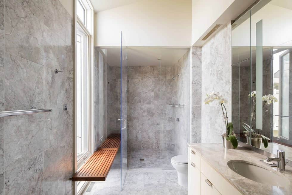 This bathroom boasts gorgeeous tiles walls and flooring. It offers a walk-in shower. Images courtesy of Toptenrealestatedeals.com.