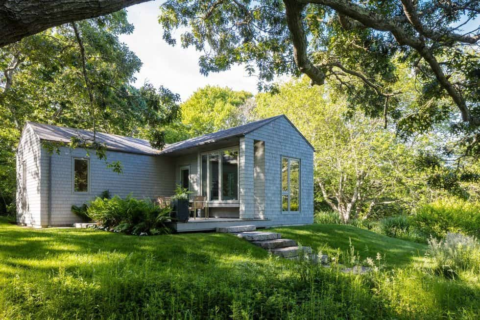 Here's a small house with a deck patio, set in the home's greenery. Images courtesy of Toptenrealestatedeals.com.