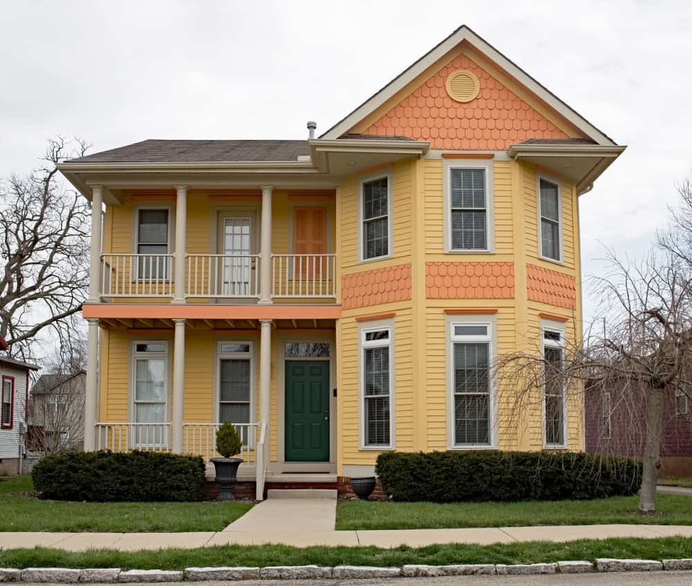 Traditional home with yellow and orange siding.