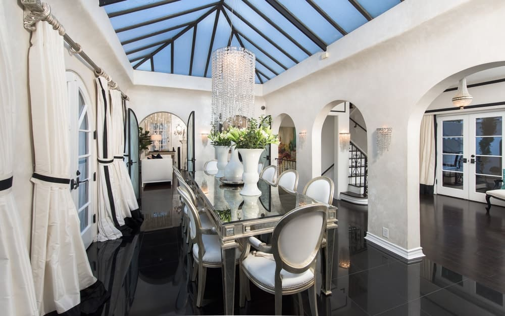 The bright walls of the dining room is illuminated by the arched ceiling made of glass and balanced by the dark hardwood flooring for a unique aesthetic. Images courtesy of Toptenrealestatedeals.com.