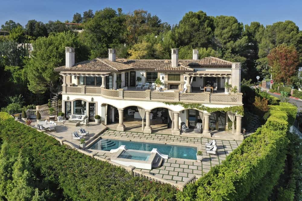 This aerial shot of the back of the house shows its lovely arches and wide balconies overlooking the beautiful swimming pool of the backyard. Images courtesy of Toptenrealestatedeals.com.