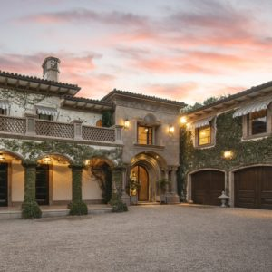 This gorgeous mansion has an elegant flair to its exterior walls adorned by creeping plants and arches. Images courtesy of Toptenrealestatedeals.com.