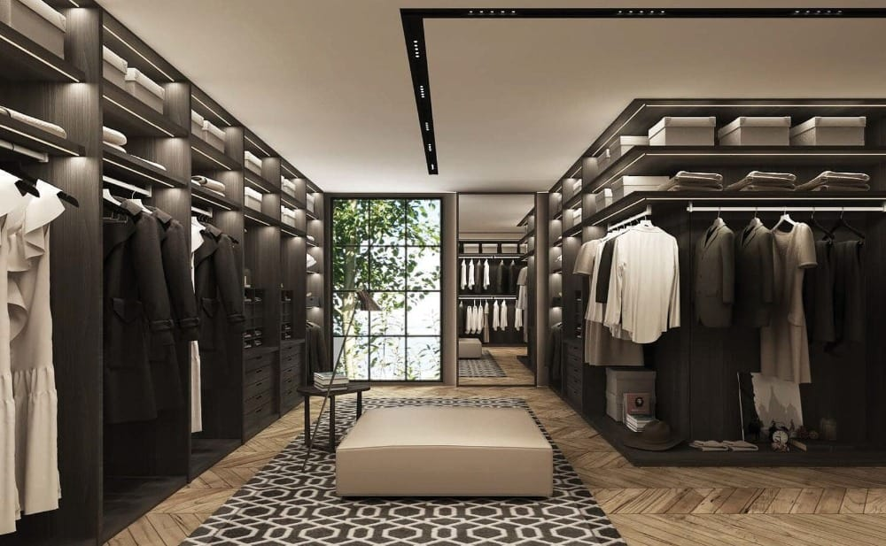 A large and luxurious walk-in closet featuring stylish herringbone-style hardwood flooring. Images courtesy of Toptenrealestatedeals.com.