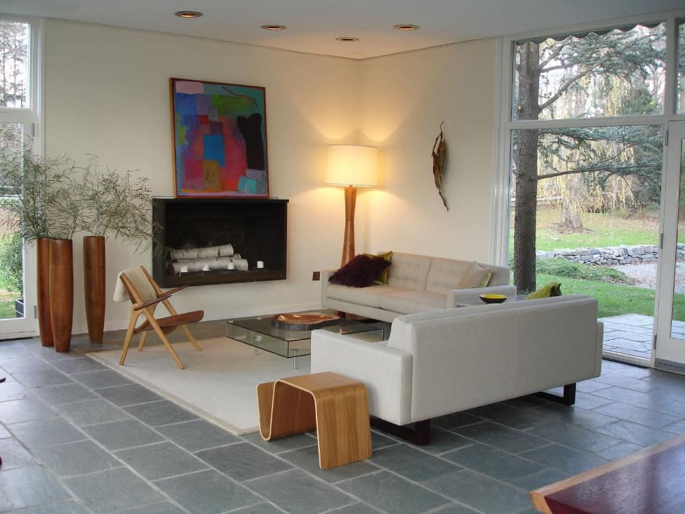 This living space has a pair of nice couches and a modish glass center table on top of an area rug. Images courtesy of Toptenrealestatedeals.com.