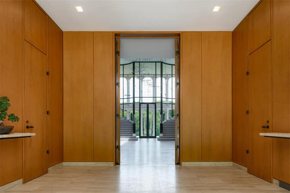 The foyer leads to this hallway that has wooden walls that match the doors. Images courtesy of Toptenrealestatedeals.com.