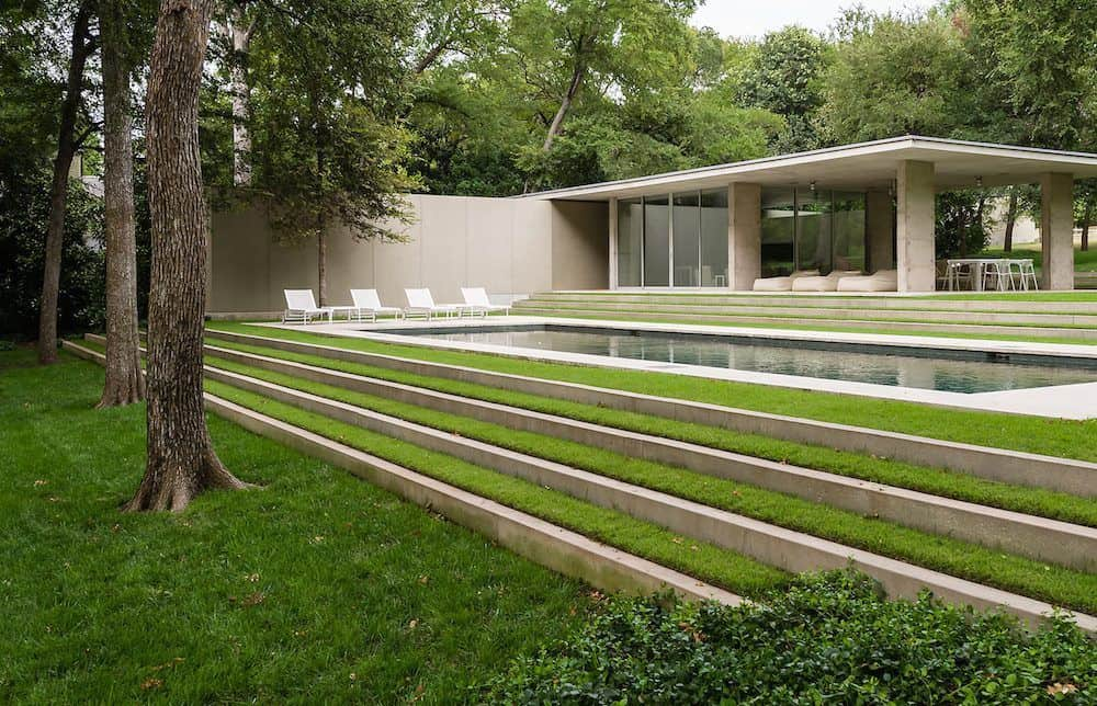This is the pool that is surrounded by lush green lawns of grass that look well-maintained. These are then paired with tall walls and tall trees that provide privacy to the area. Images courtesy of Toptenrealestatedeals.com.