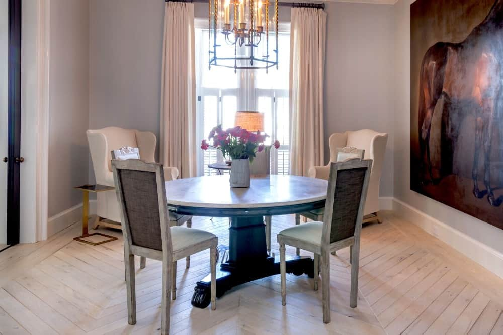 A focused look at the classy dining nook with a round dining table paired with classy chairs lighted by a luxury chandelier. Images courtesy of Toptenrealestatedeals.com.