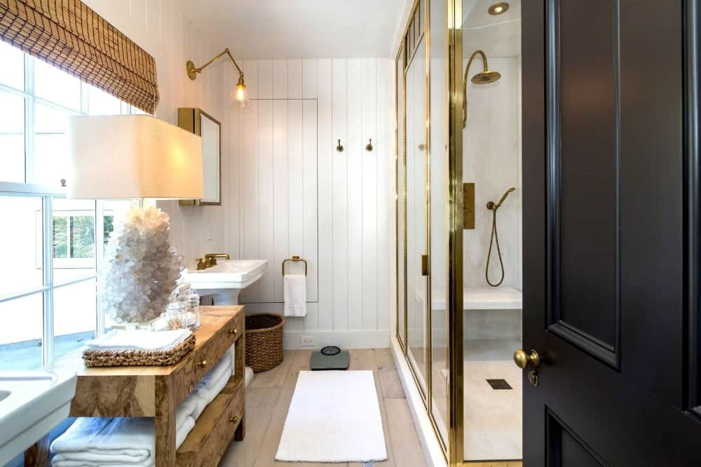 A bathroom featuring a walk-in shower room and a pedestal sink on the side. Images courtesy of Toptenrealestatedeals.com.