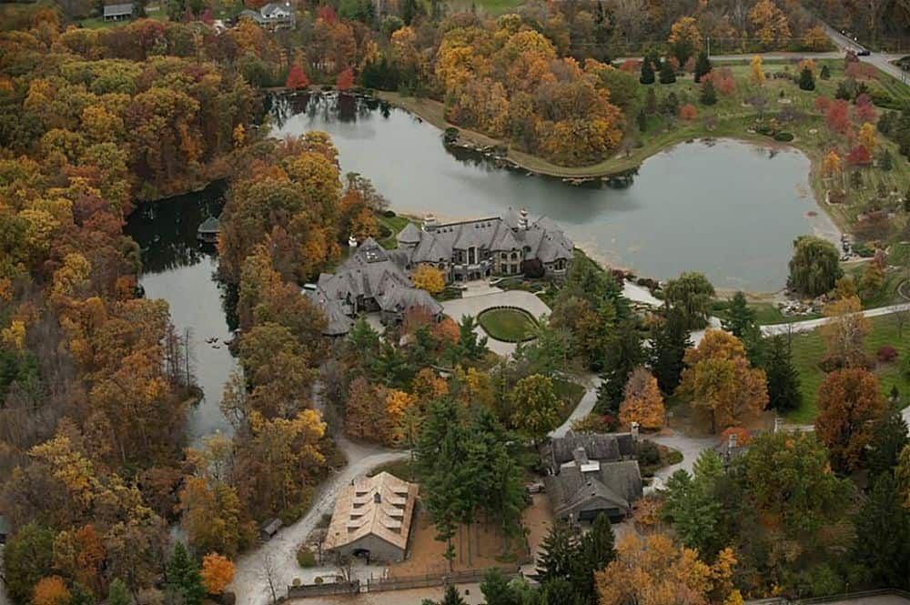 This is the aerial view of the mansion showing its large property, wide driveway, isolation and privacy that is given by the surrounding mature trees. Images courtesy of Toptenrealestatedeals.com.
