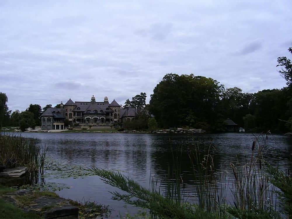 This is the view of the mansion from the vantage of the lake. You can better appreciate here the lush landscaping that surrounds the house filled with tall trees. Images courtesy of Toptenrealestatedeals.com.