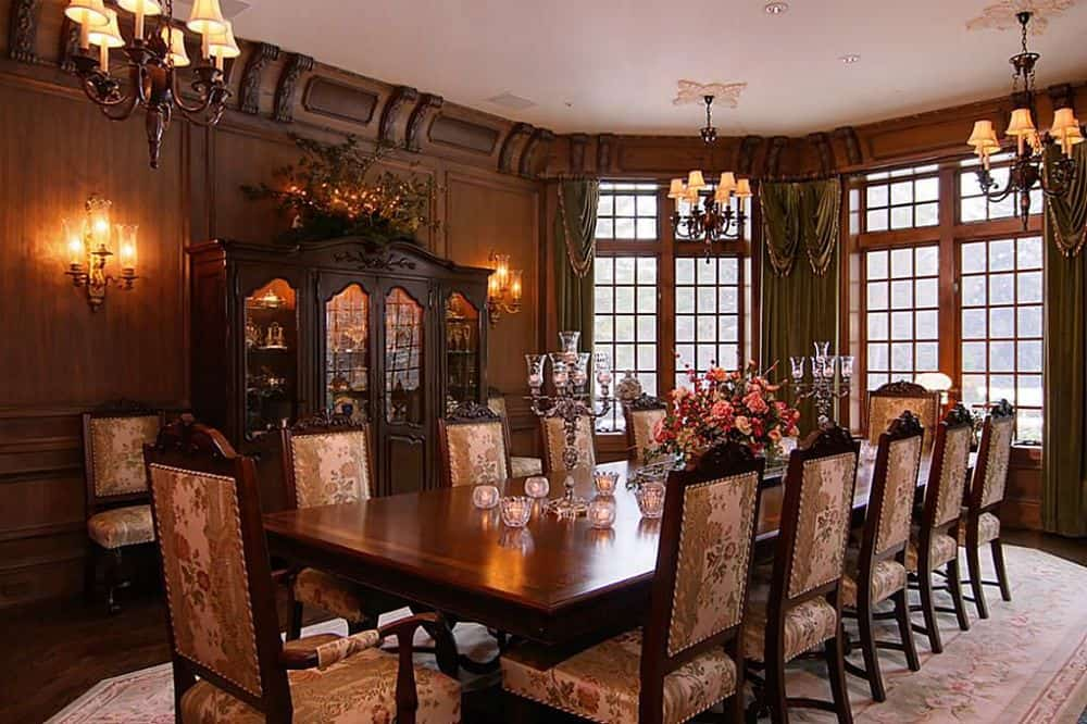 This is agrand and formal dining room that has a large rectangular wooden dining table surrounded by matching wooden chairs that has cushioned seats and backs topped with a couple of small chandeliers. Images courtesy of Toptenrealestatedeals.com.