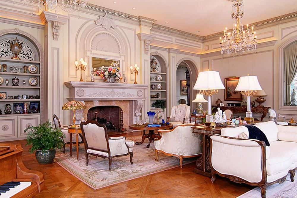 This is the elegant living room of the mansion that has a fireplace across from the gorgeous sofa set and wooden coffee table on a light area rug that covers the hardwood flooring. Images courtesy of Toptenrealestatedeals.com.