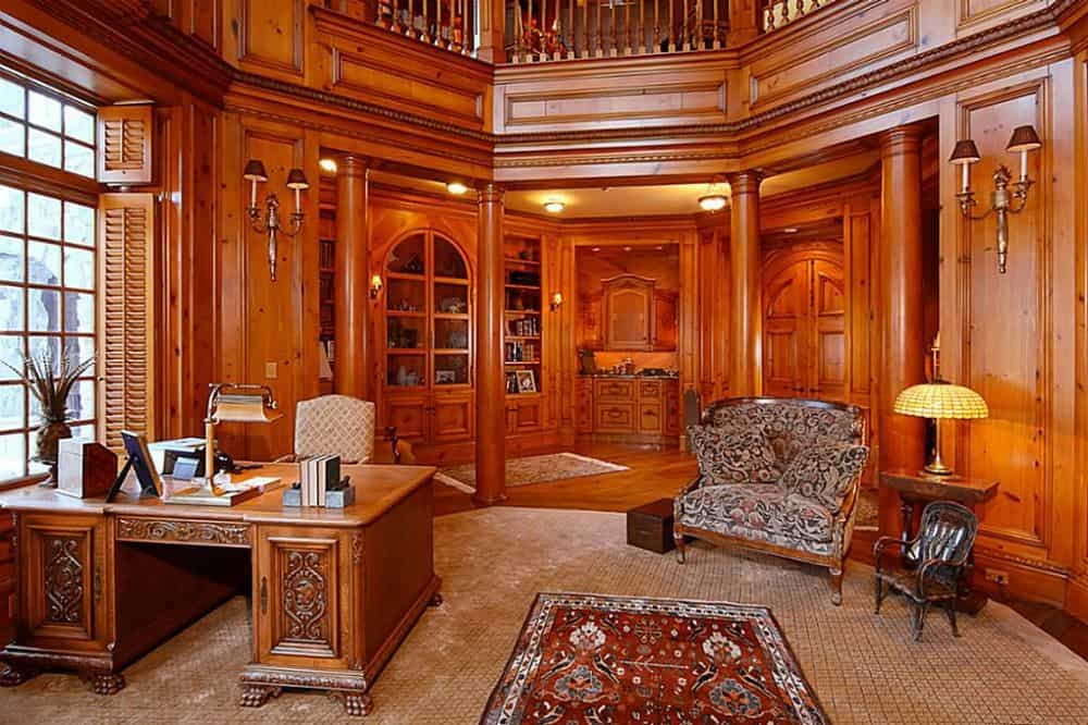 This is the home office and library that reaches to a second level. The office has a rich wooden desk that pairs well with the walls and built-in cabinetry. Images courtesy of Toptenrealestatedeals.com.