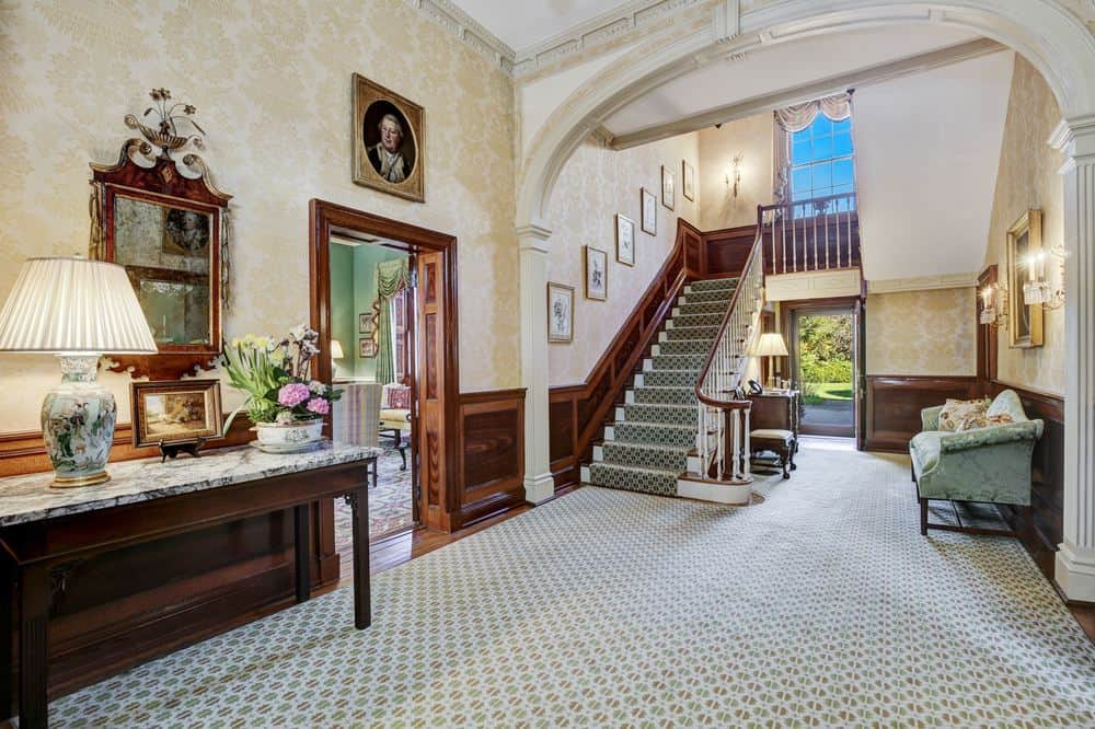 This foyer leads the way to the staircase through the tall archway. There is also a couple of wooden doors leading to the different sections of the house. Images courtesy of Toptenrealestatedeals.com.