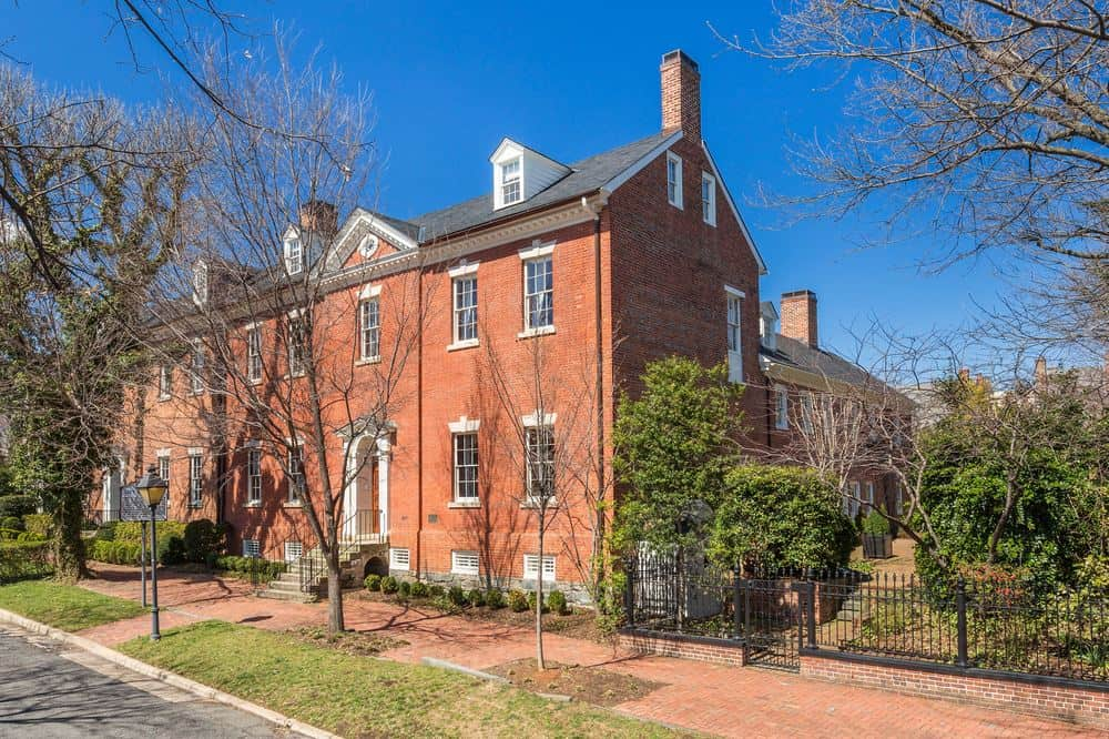 This is the front view of the house from the vantage point of the street. You can see here the charming red brick exterior walls of the house that is complemented by the terracotta sidewalk and the chimneys. Images courtesy of Toptenrealestatedeals.com.