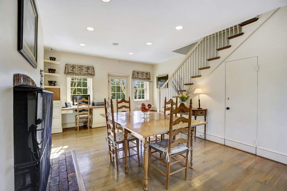 A few steps from the kitchen is this intimate informal dining area just beside the stairs. This has a simple wooden dining set that matches the hardwood flooring. Images courtesy of Toptenrealestatedeals.com.