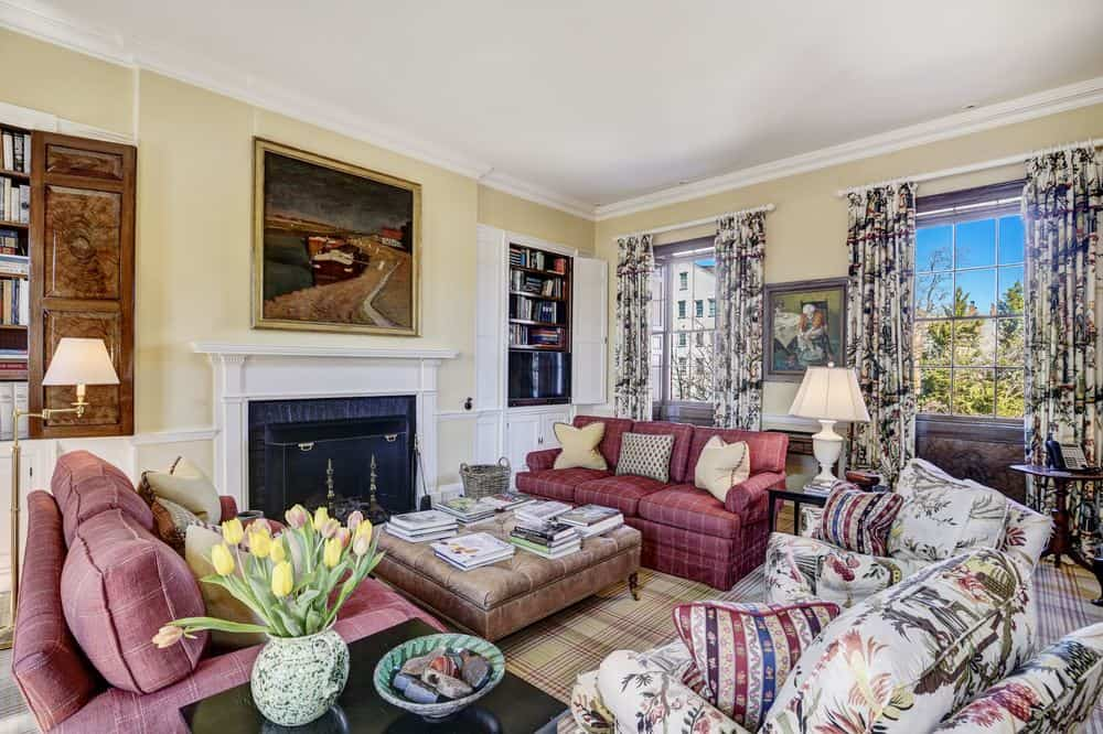 This is a cozy living room with a warm embrace of the fireplace across from the various sofas with contrasting pillows. Images courtesy of Toptenrealestatedeals.com.