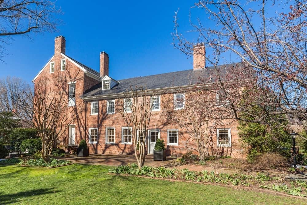 This is the side of the house lined with tall trees that complement the charming red brick exterior walls. You can also see here the multiple windows of the two levels. Images courtesy of Toptenrealestatedeals.com.