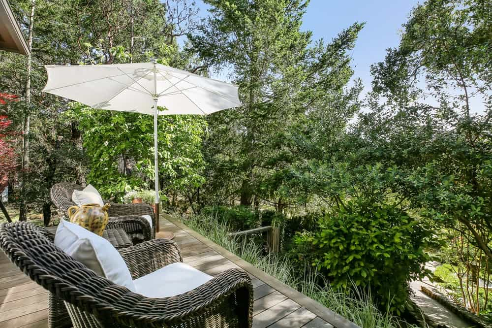 This balcony and terrace has a couple of comfortable woven wicker arm chairs with cushions facing the beautiful treetop view of the surrounding landscape. Images courtesy of Toptenrealestatedeals.com.