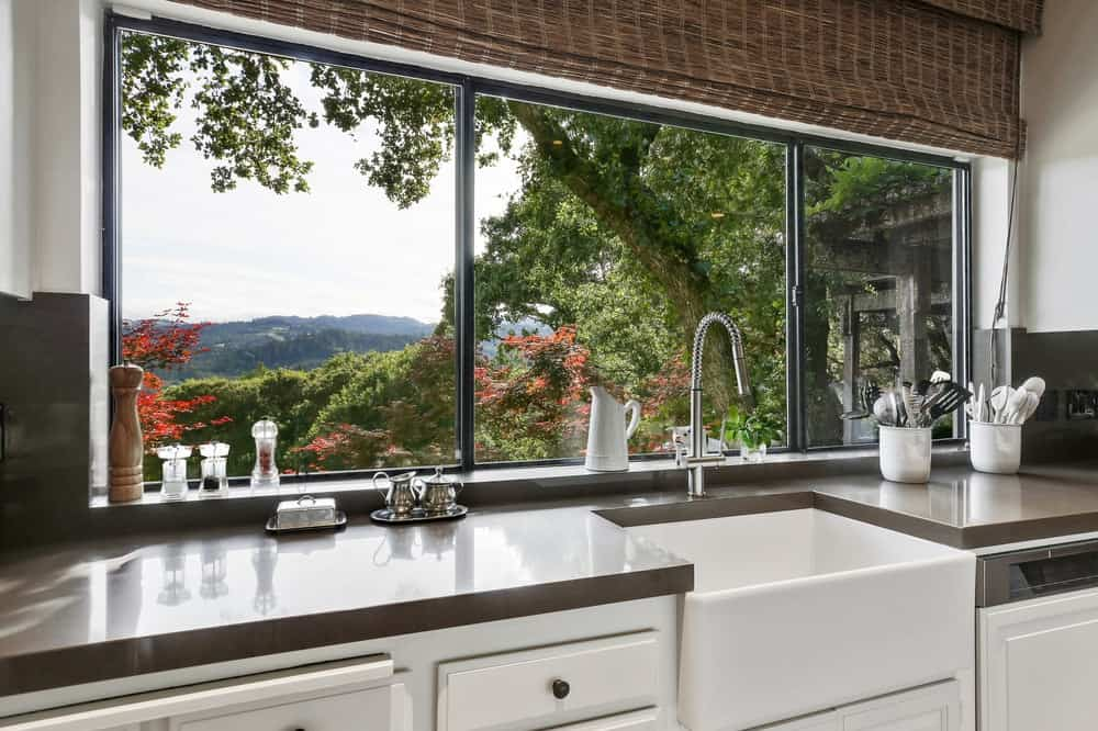 The other side of the cooking area is this bright faucet area with a wide row of windows that gives a scenic view of the mountains. Images courtesy of Toptenrealestatedeals.com.