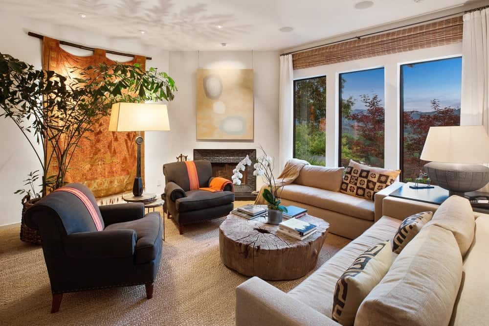 This other living room has a simpler vibe to its light hardwood flooring, beige sofas and black fireplace matching the two arm chairs. Images courtesy of Toptenrealestatedeals.com.